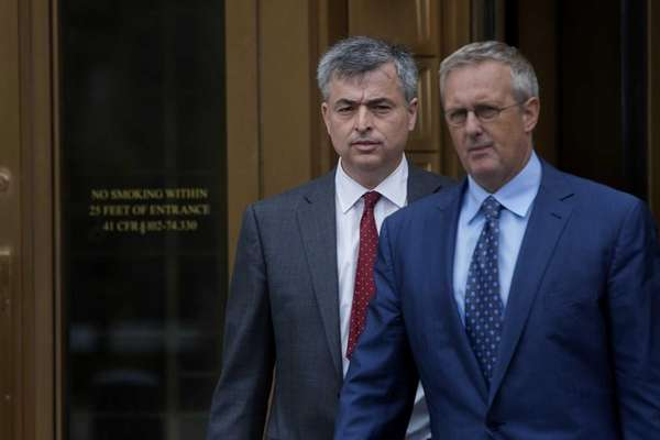 Eddy Cue, left, who led Apple negotiations with