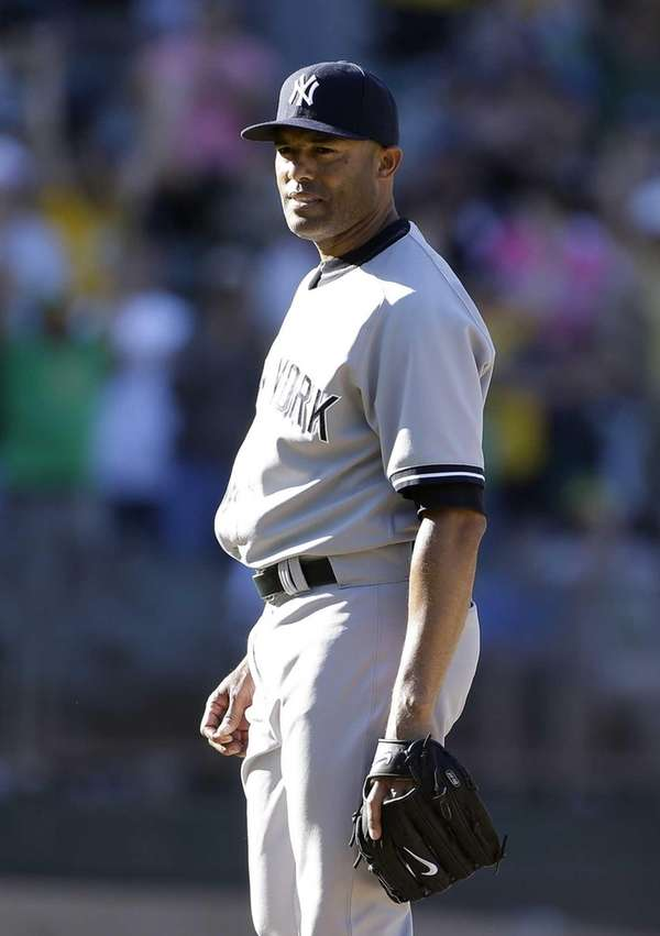 Yankees pitcher Mariano Rivera stands on the mound