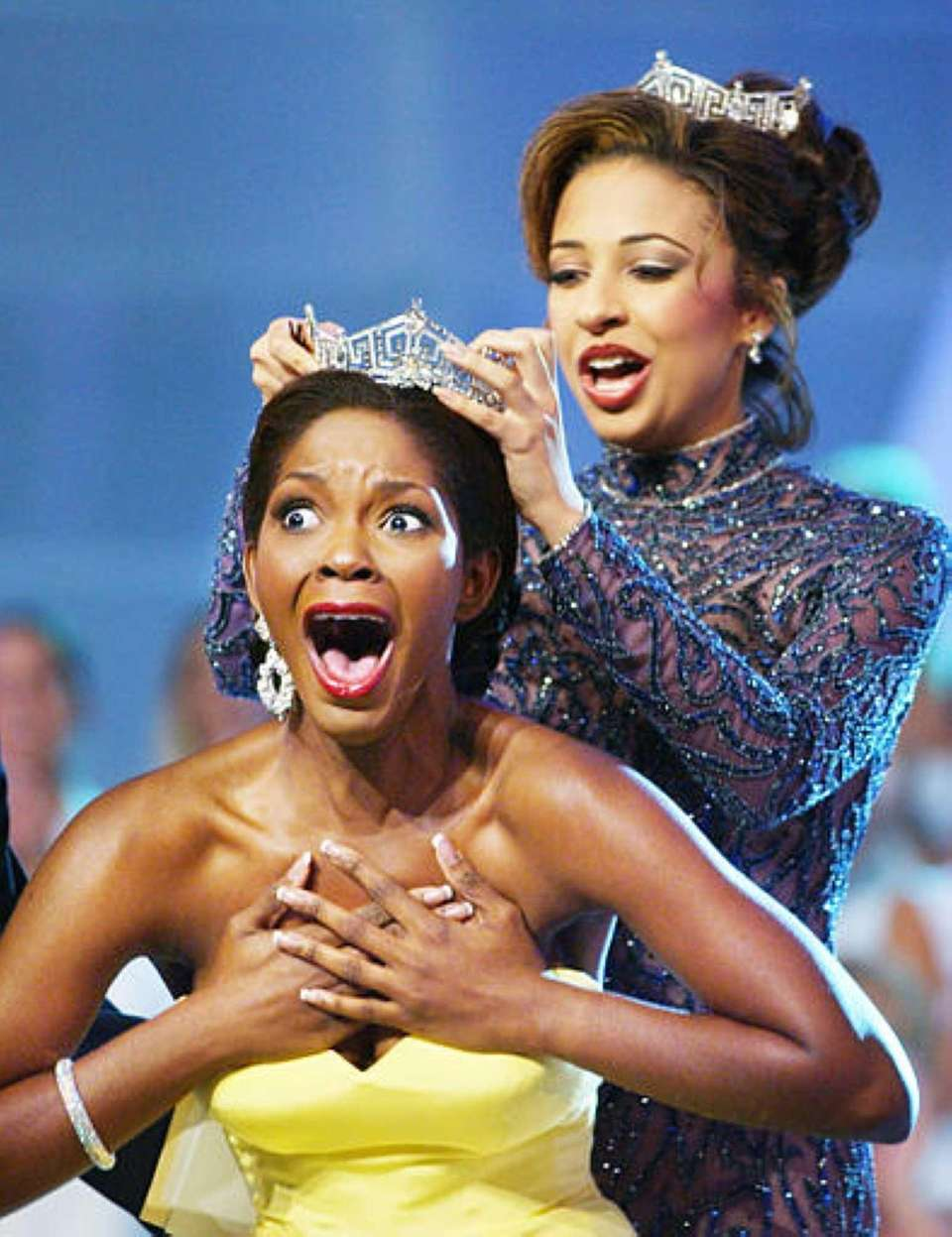Miss Florida Ericka Dunlap, left, reacts after being