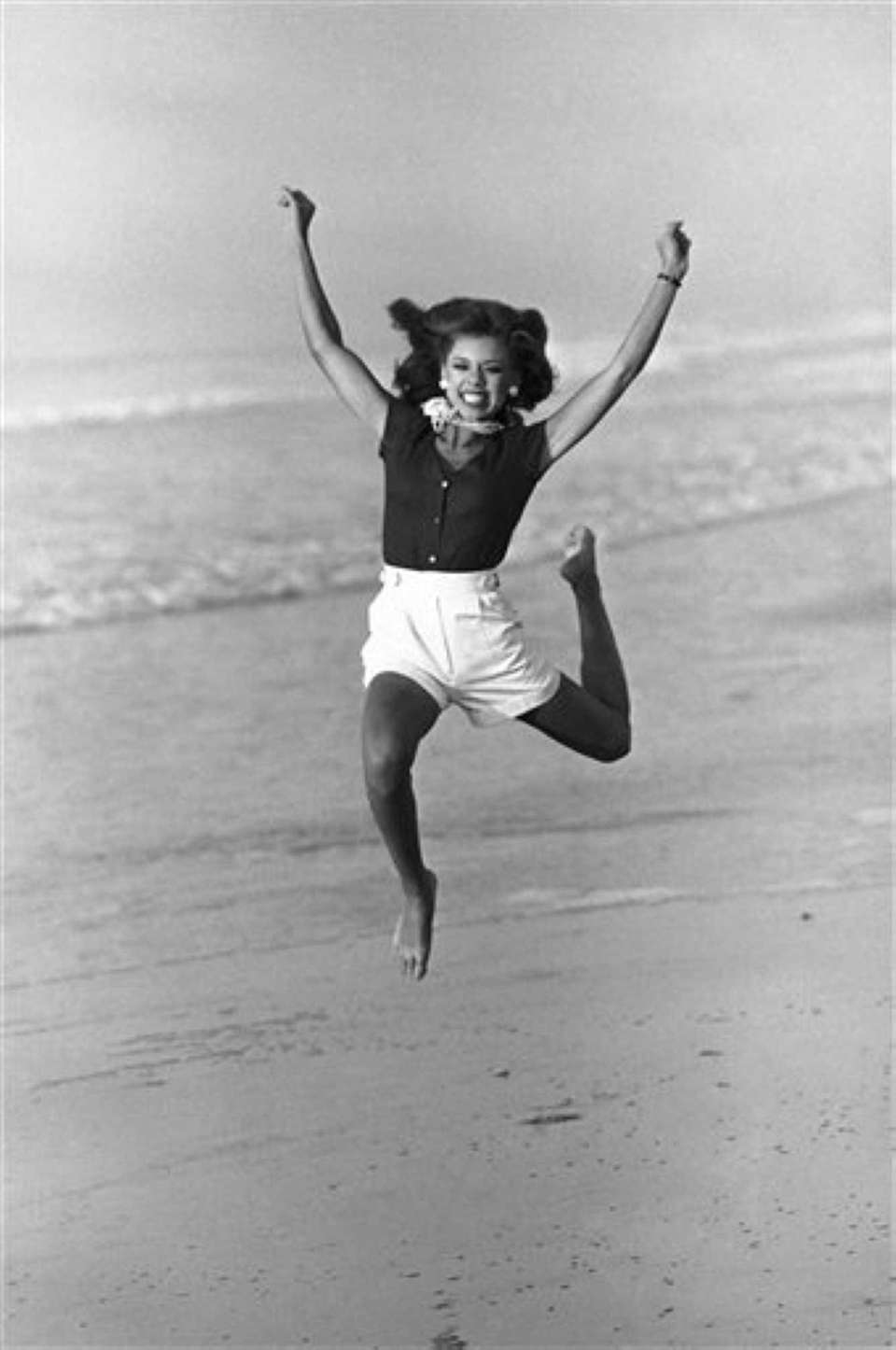 Vanessa Williams, Miss America 1984, jumps for photographers