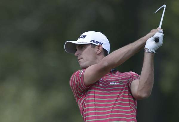 Billy Horschel of the United States follows through