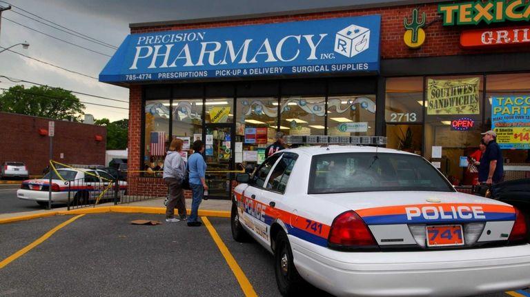 Nassau Police investigate a robbery at Precision Pharmacy