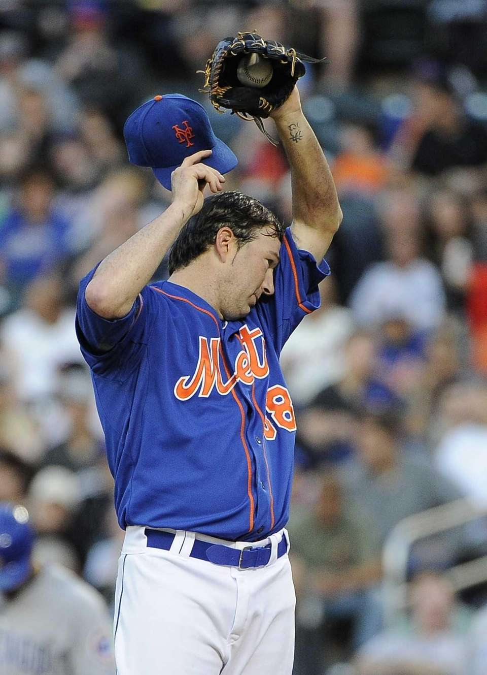 Starting pitcher Shaun Marcum of the Mets reacts