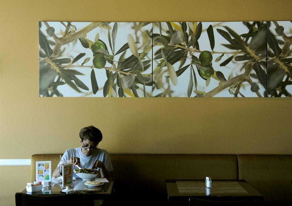A customer enjoys the Greek salad at Gyrolicious