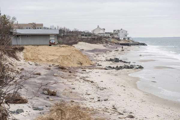 Erosion damage caused by superstorm Sandy in front