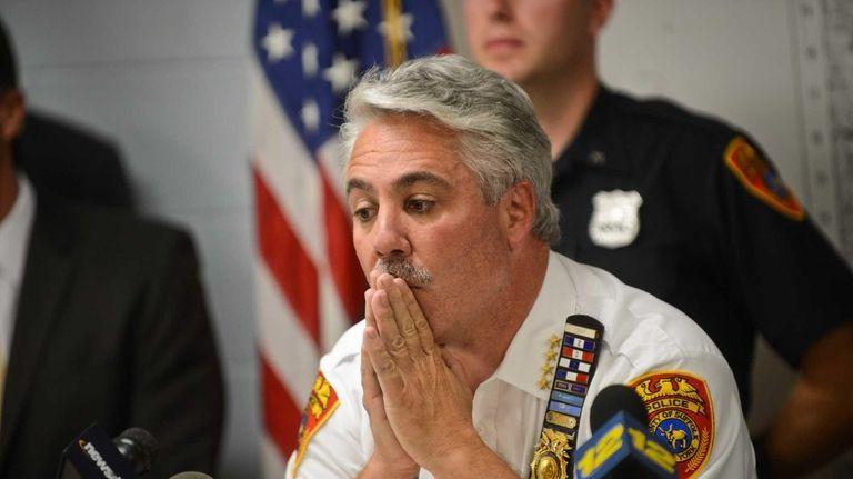 Chief of Police James C. Burke speaks as