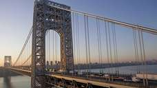The George Washington Bridge spans the Hudson River