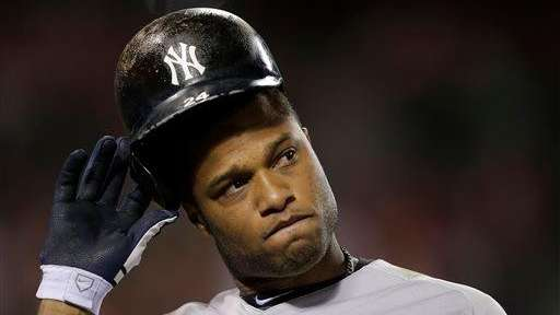 Robinson Cano grimaces after an at-bat during a