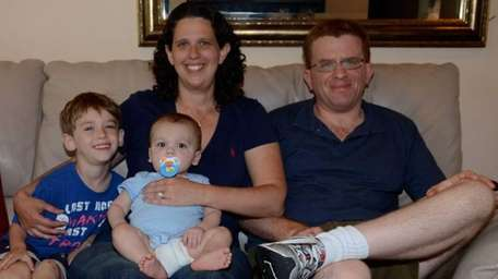Bethpage's Karen and Jon DeRise with their sons,