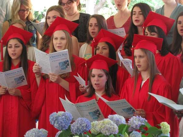 "The Upper School choir performed ""Omnia Sol (Let"