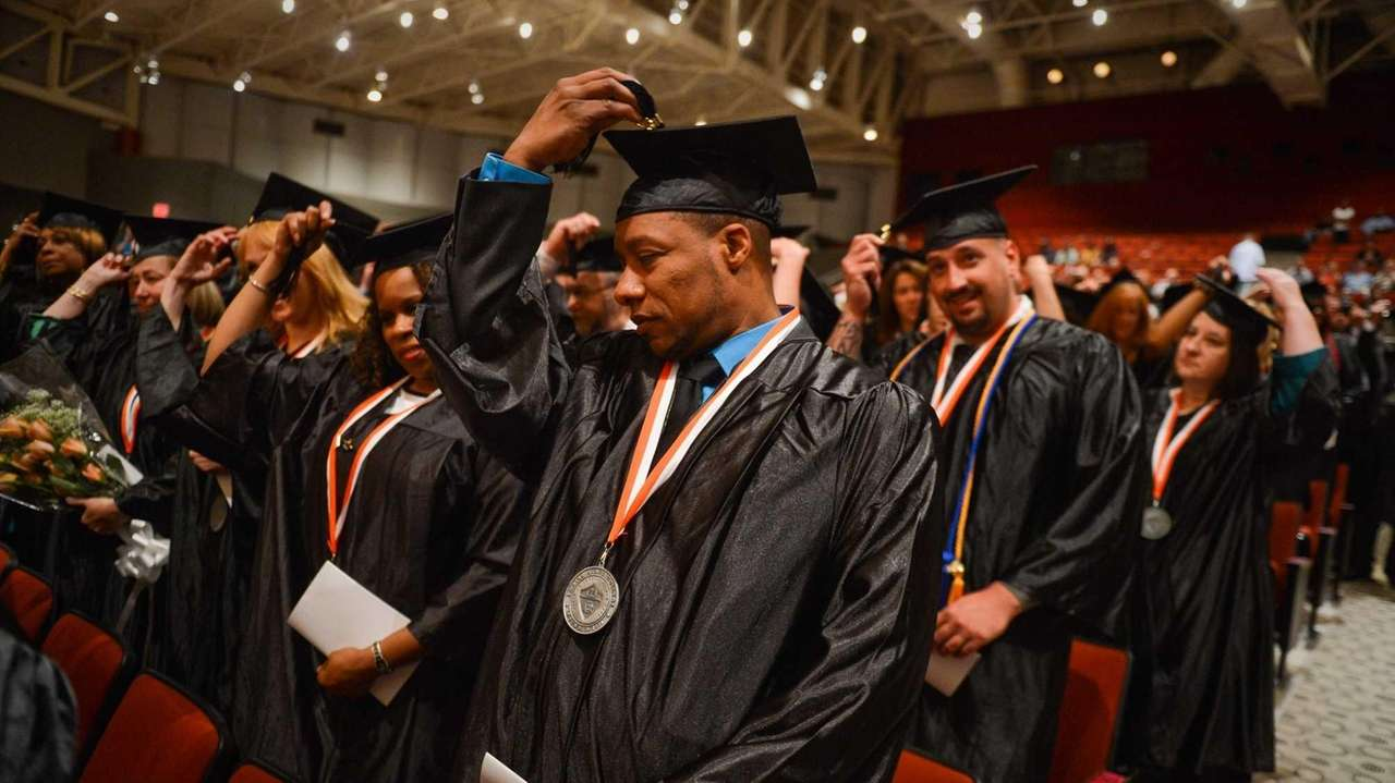 Students move their tassels during the Empire State