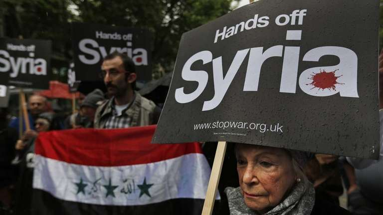 Protesters demonstrate against western intervention in Syria, outside
