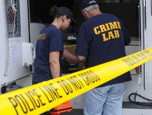 Crime lab investigators and the arson squad are