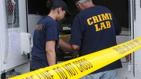Crime lab investigators and the arson squad are
