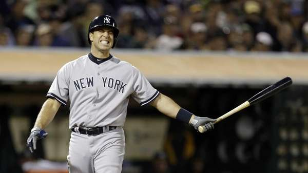 New York Yankees' Mark Teixeira reacts after taking