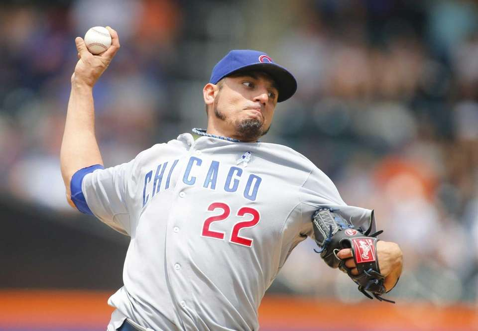 Matt Garza of the Chicago Cubs pitches against