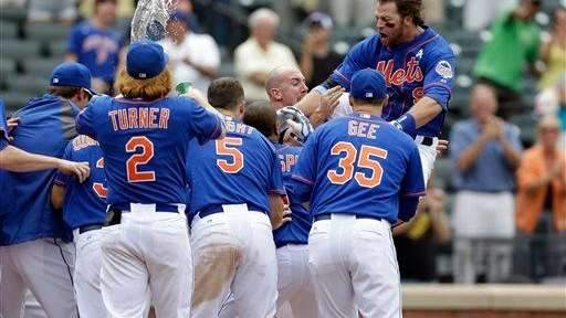Kirk Nieuwenhuis dives into a throng of teammates