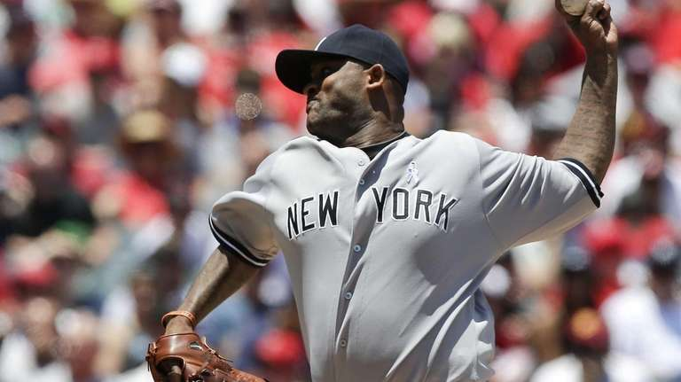 CC Sabathia delivers a pitch during the first