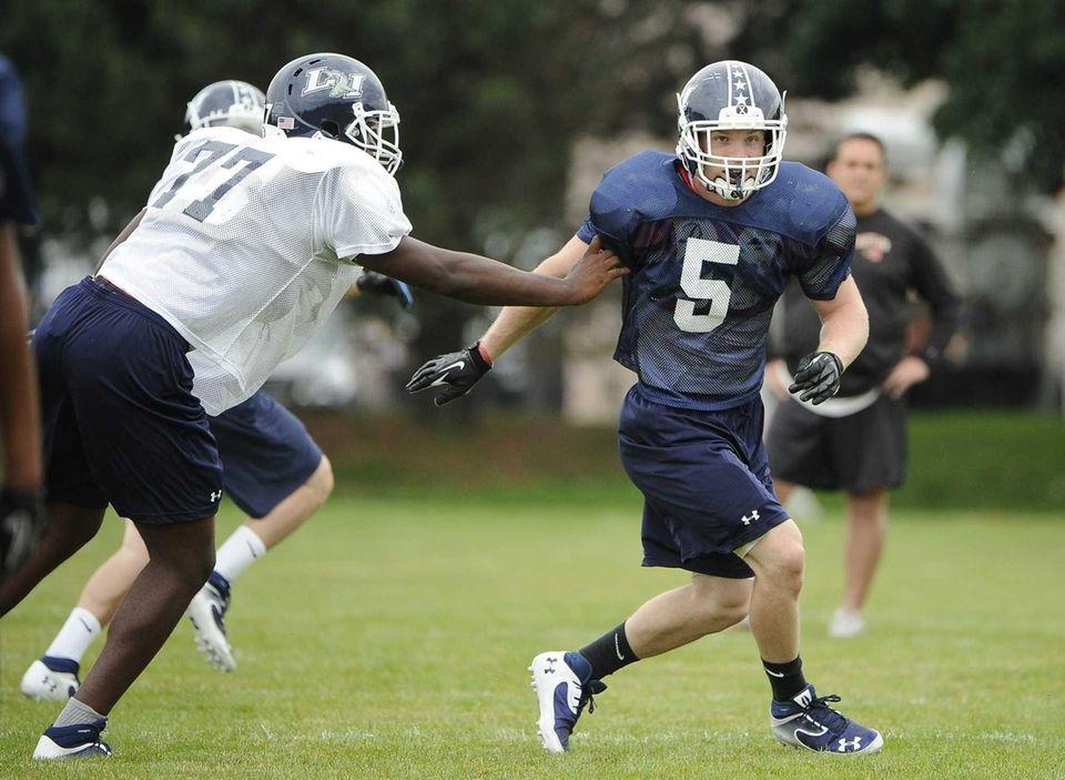 Long Island middle linebacker Steven Casali practices for