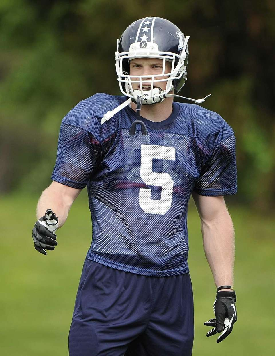 Long Island middle linebacker Steven Casali practices for