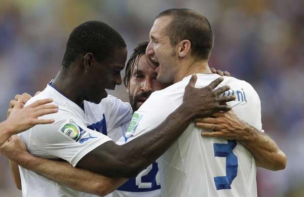 Italy's Andrea Pirlo, center, is celebrated by his