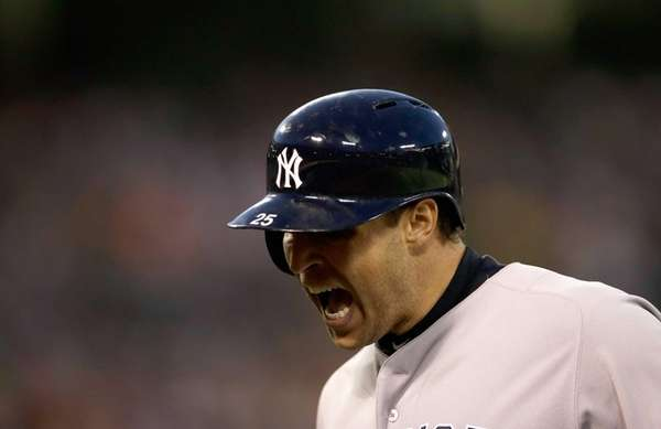 Mark Teixeira reacts after hitting a sacrifice fly