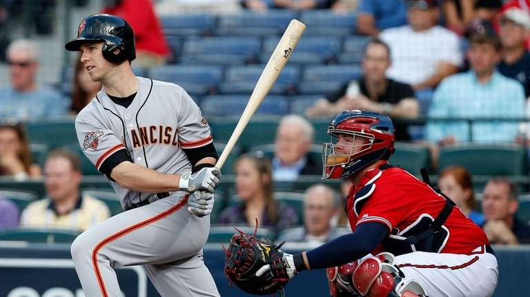 Buster Posey of the San Francisco Giants follows
