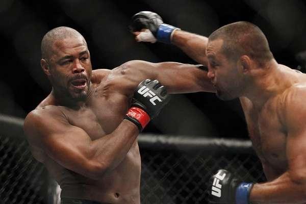 Rashad Evans,left, and Dan Henderson battle during UFC