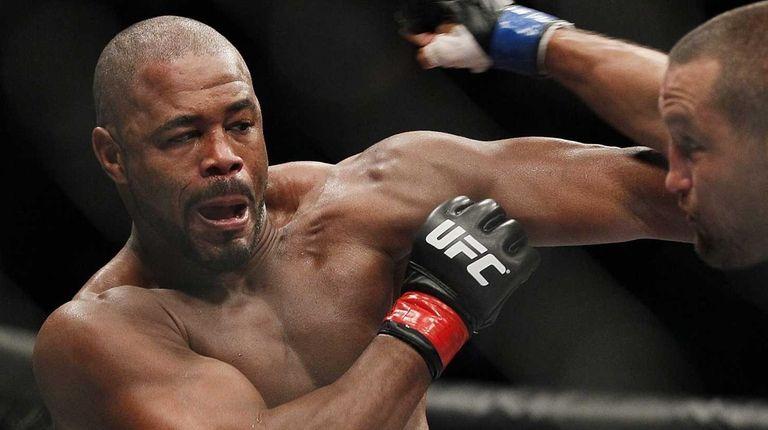 Rashad Evans,left, and Dan Henderson battle during UFC