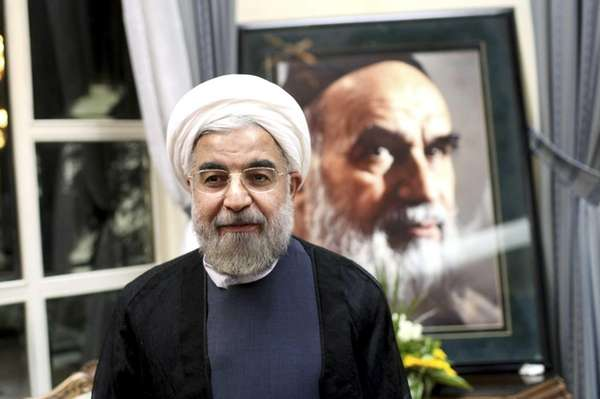 Iranian President elect Hasan Rowhani, stands in front