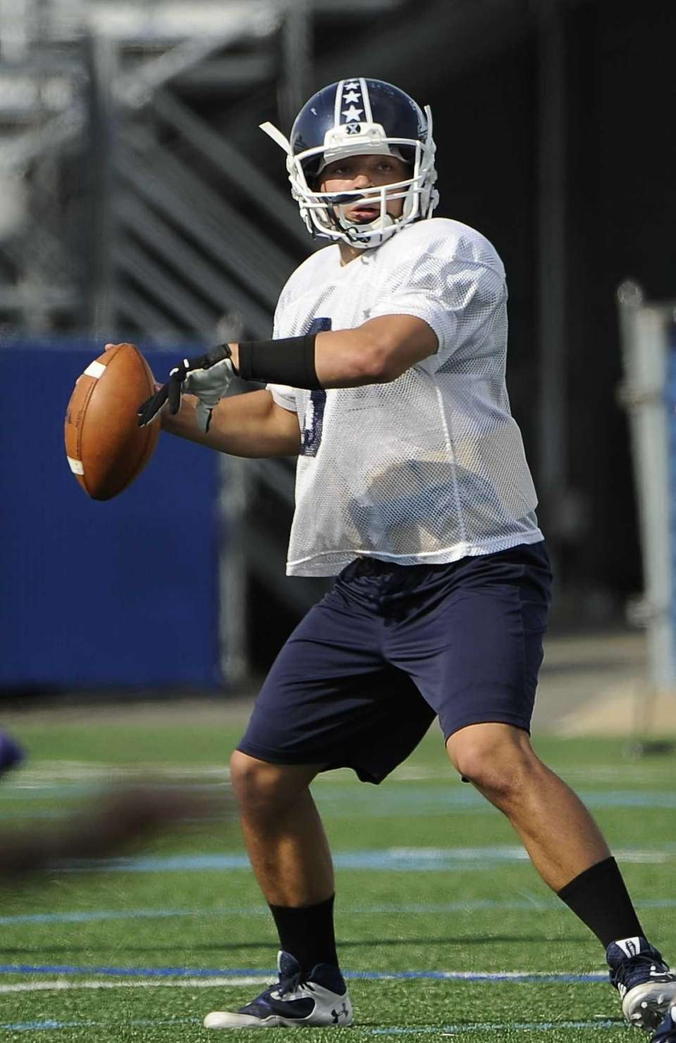 Long Island quarterback AJ Otranto looks for an