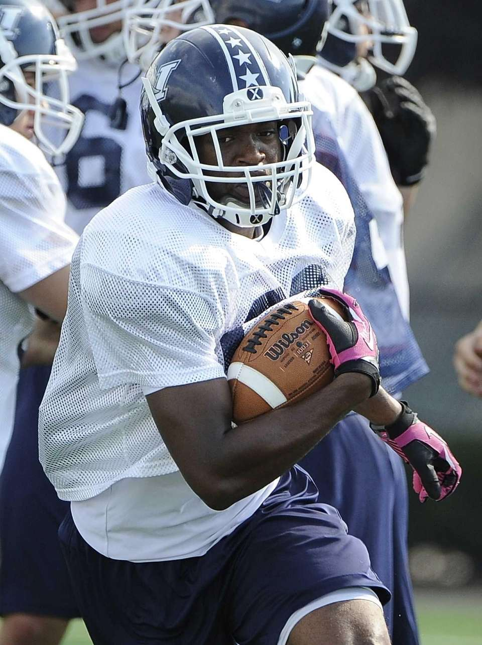 Long Island running back William Stanback runs with