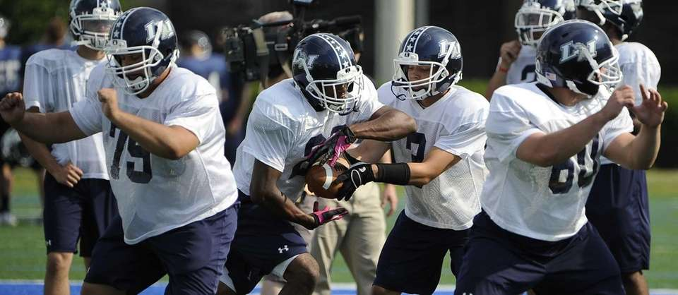 Long Island quarterback AJ Otranto hands the ball