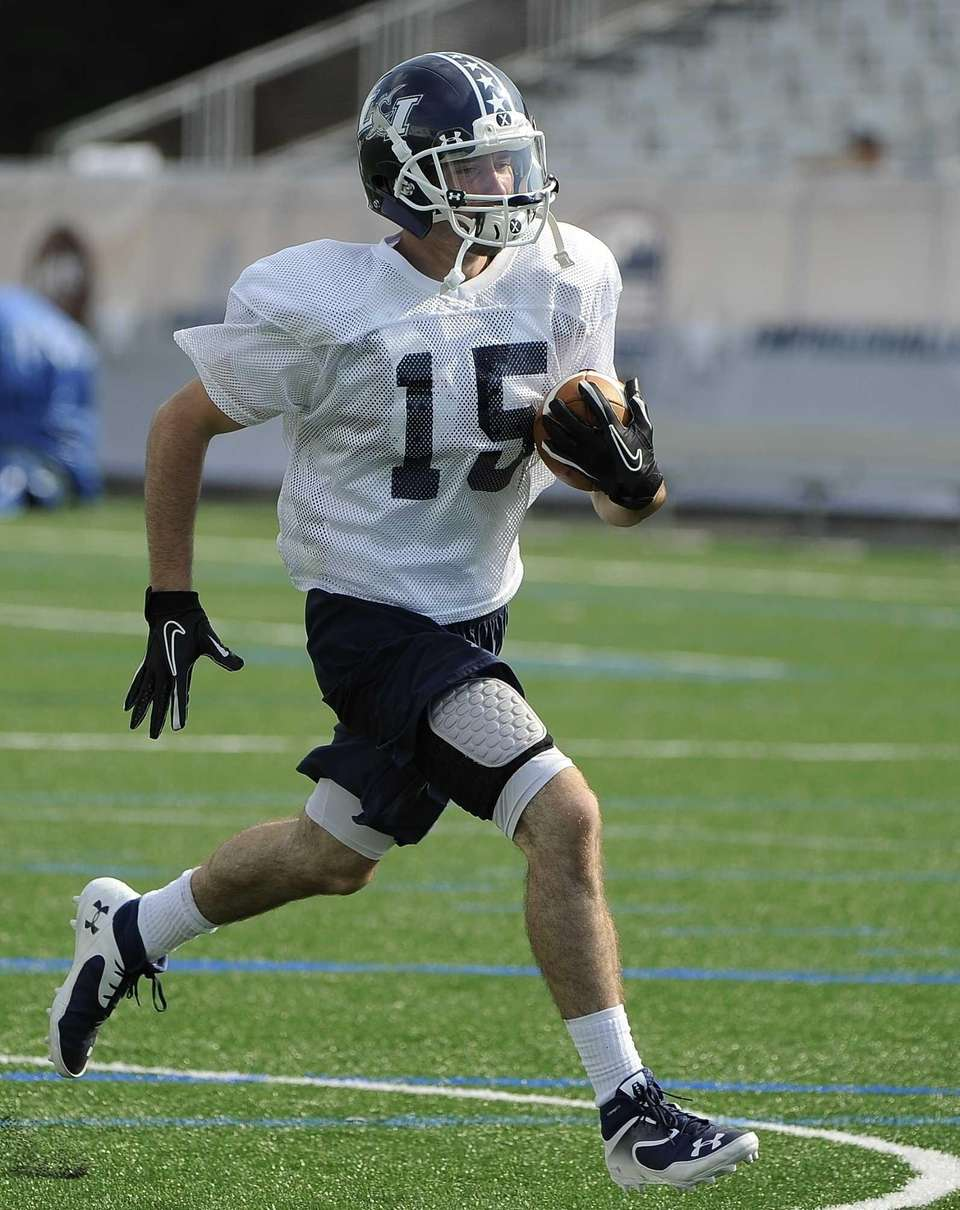 Long Island wide receiver James Higgins runs with