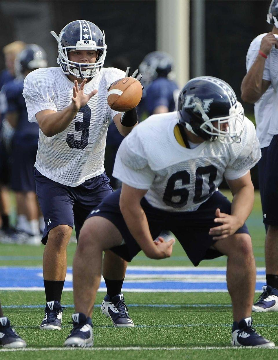 Long Island quarterback AJ Otranto receives a snap