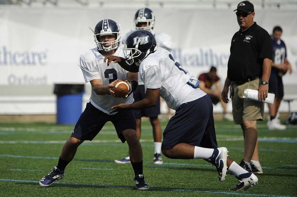Long Island quarterback AJ Otranto hands the bal