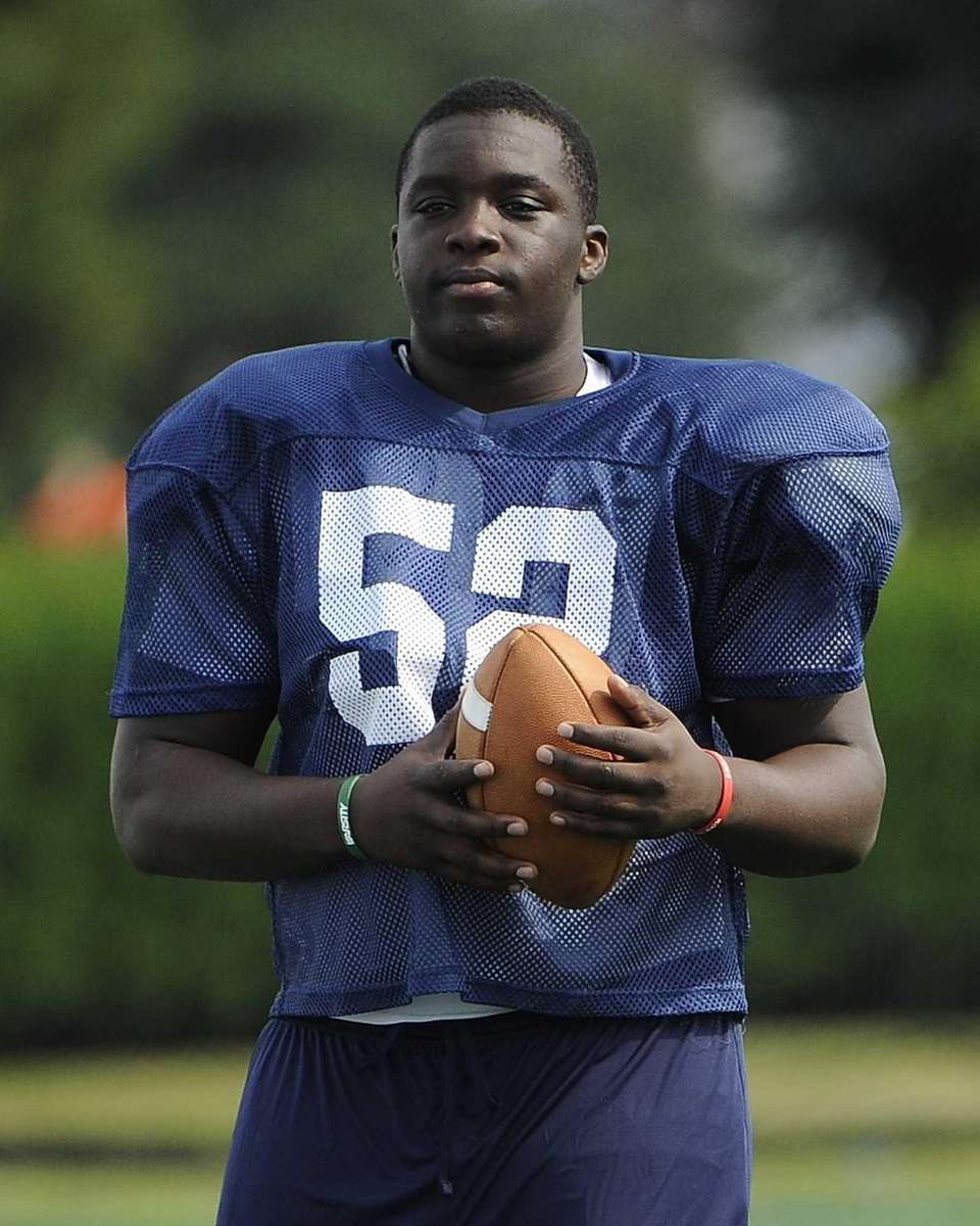 Long Island's Ousmane Camara looks on during practice
