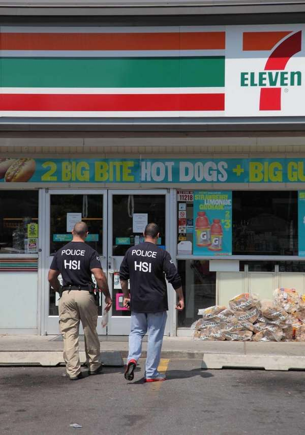 Federal agents stand outside of a 7-11 in