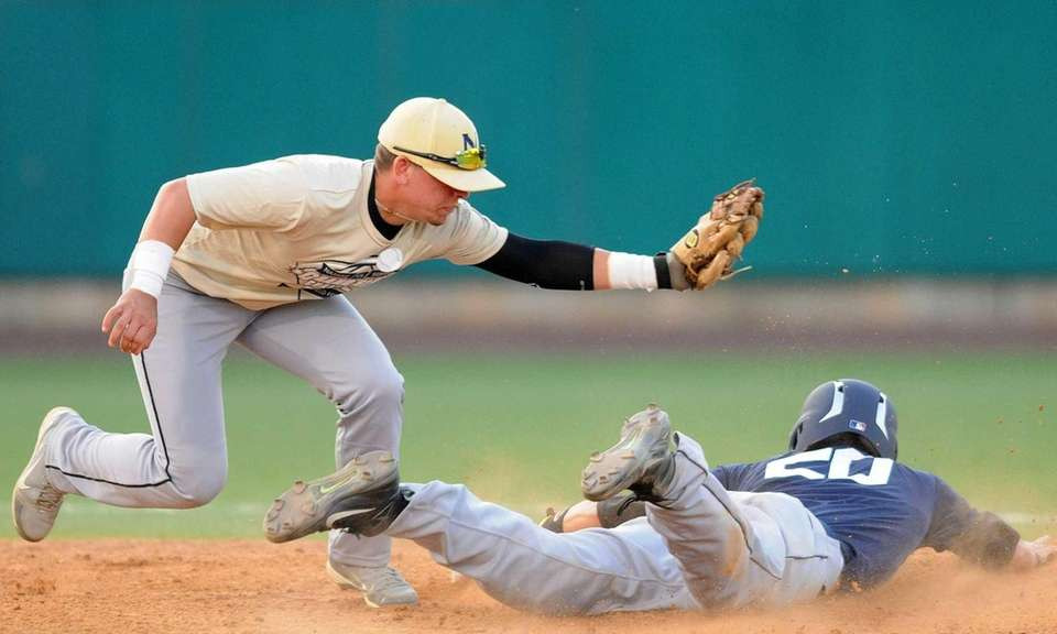 Nassau shortstop Michael Stack (Wantagh) tags out Suffolk's