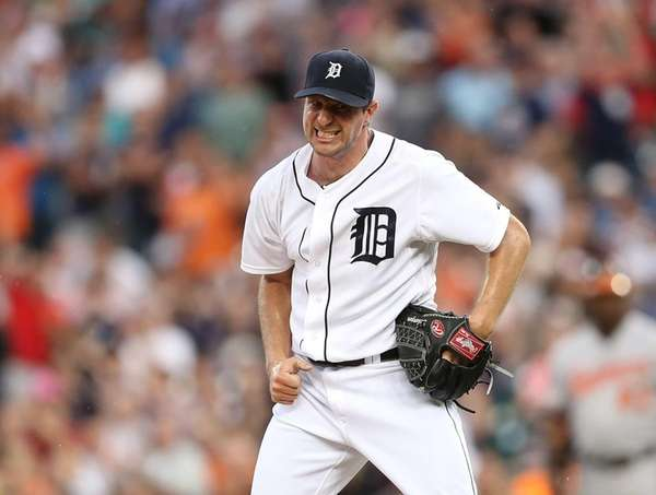 Detroit Tigers pitcher Max Scherzer reacts after striking