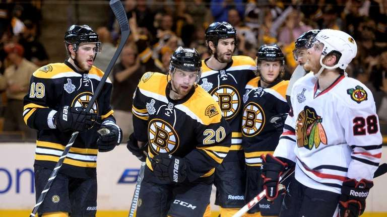 Daniel Paille of the Boston Bruins celebrates with
