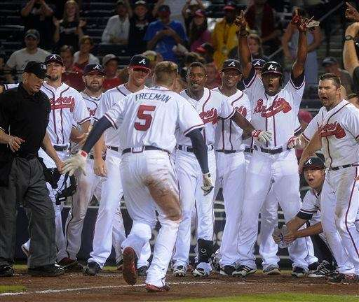 Atlanta Braves first baseman Freddie Freeman approaches home