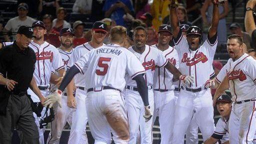 Atlanta Braves first baseman Freddie Freeman approaches home