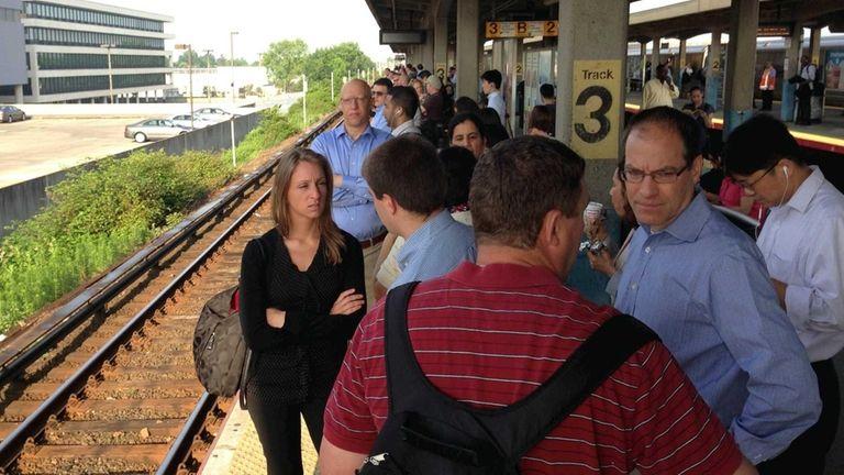 Commuters wait for a Long Island Rail Road