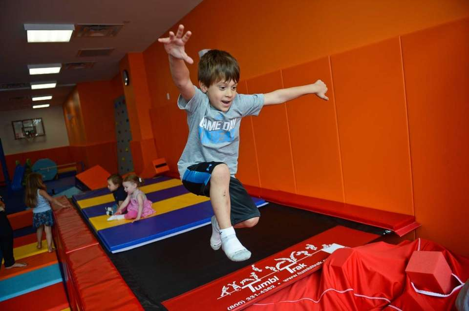 Louis D'Agostino, 6, of Hewlett, jumps into a