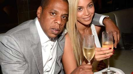 Jay Z and Beyoncé attend The 40/40 Club