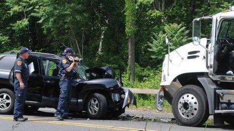 A detective investigates a crash involving an SUV