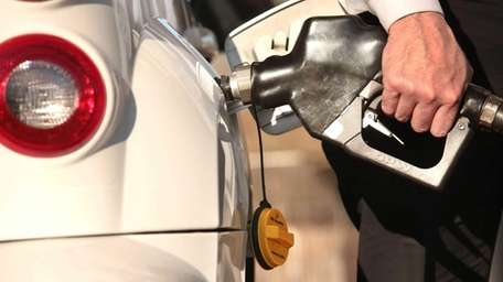 Customers pump gasoline at the Gulf station at