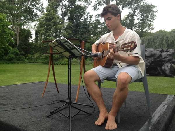 Clark Hamilton, 18, of Springs, plays acoustic guitar