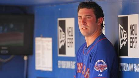 Mets starting pitcher Matt Harvey watches from the